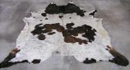 White Cowhide rug with brown spots